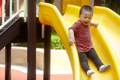 Young boy on slide Stock Image