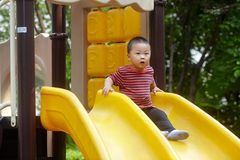 Young boy on slide Royalty Free Stock Photos