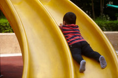 Young boy on slide Stock Photography