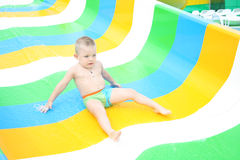 Young boy sliding Royalty Free Stock Photos