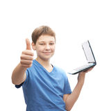 Young boy with a small notebook computer Stock Photos
