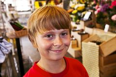 Young boy smiles in a shop Royalty Free Stock Photography