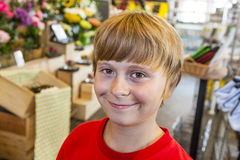 Young boy smiles in a shop Stock Photo