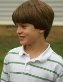 Young boy - smiling. Preteen boy in polo shirt Royalty Free Stock Photography