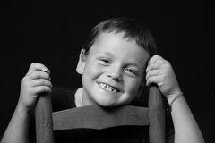 Young boy smiling. Monochrome portrait of a young boy stock photography