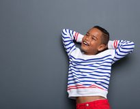 Young boy smiling with arms behind head Royalty Free Stock Images