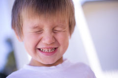 Young boy smiling eyes closed. Portrait happy boy smiling with eyes closed royalty free stock photos