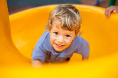 Young boy smiling having fun in the park Royalty Free Stock Image