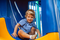 Young boy smiling having fun in the park Royalty Free Stock Photos