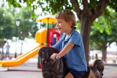 Young boy smiling having fun in the park Royalty Free Stock Photography