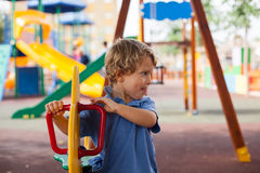 Young boy smiling having fun in the park Royalty Free Stock Images