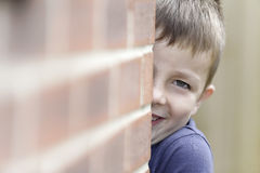 Young boy smiling playing Royalty Free Stock Photo