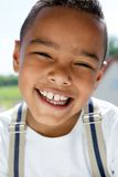 Young boy smiling with suspenders Stock Images