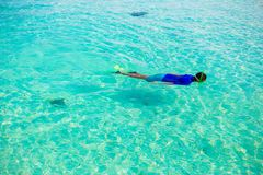Young boy snorkeling in tropical turquoise ocean Royalty Free Stock Image
