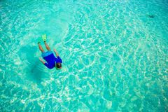 Young boy snorkeling in tropical turquoise ocean Stock Images