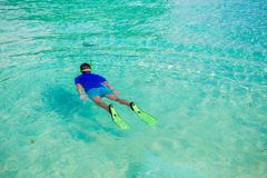 Young boy snorkeling in tropical turquoise ocean Royalty Free Stock Images