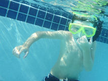 Young boy snorkeling underwater Royalty Free Stock Image