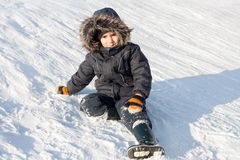 Young boy on snow Stock Image