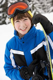Young Boy With Snowboard On Ski Holiday Royalty Free Stock Photos