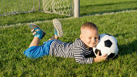 Young boy with a soccer ball Stock Image