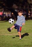 Young boy with soccer ball in park Royalty Free Stock Images
