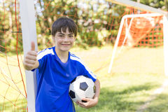 Young boy with soccer ball on a sport uniform Stock Photo