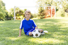 Young boy with soccer ball on a sport uniform Royalty Free Stock Photos