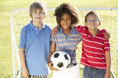 Young Boy With Soccer Ball Standing By Goal Stock Image