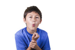 Young boy with sore wrist. Young boy holding his sprained wrist - on white background royalty free stock image