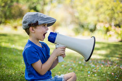 Young boy speaking on megaphone Royalty Free Stock Photography