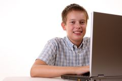 Young boy spending time with notebook Stock Photo