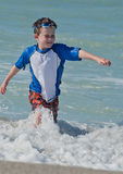 A young boy splashing Stock Images