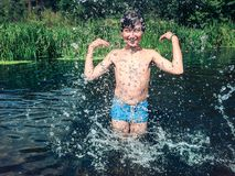 Young boy splashing in the water in the summer Stock Photography