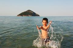 Young boy splashing in water Royalty Free Stock Image