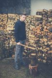 Young boy prepares firewood with axe Royalty Free Stock Images