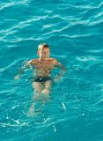 Boy swiming at red sea. Young boy sportsman Boy swiming at red sea royalty free stock photos