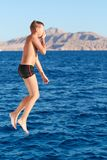 Boy swiming at red sea Royalty Free Stock Images