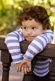 Young boy standing against railing Stock Images