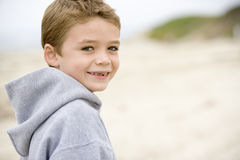 Young boy standing on beach Royalty Free Stock Photos