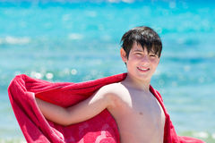 Young boy standing on the beach Royalty Free Stock Images