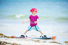 Young boy standing on board for kitesurfing stock photos