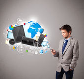 Young boy standing and browsing on his phone Stock Photo