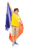 Young boy standing with French flag Stock Photography