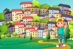 A young boy standing at the hilltop across the village Royalty Free Stock Images