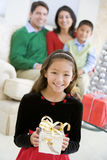 Young Boy Standing Holding Christmas Present Royalty Free Stock Photos
