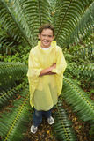 Young Boy Standing By Large Fern In Forest Stock Image