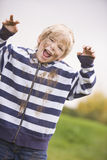 Young boy standing outdoors dirty Royalty Free Stock Images