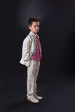 Young boy standing seriously in his First Holy Communion Royalty Free Stock Images