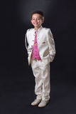 Young boy standing and smiling in his First Holy Communion Royalty Free Stock Photography