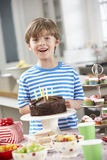 Young Boy Standing By Table Laid With Birthday Party Food Stock Photos